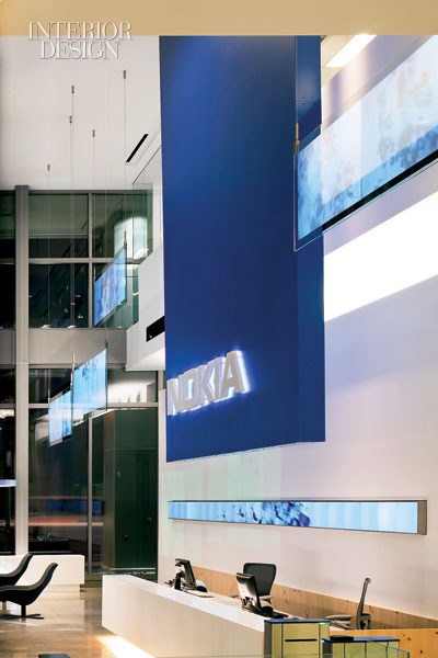 360827-Obscura_Digital_consulted_on_the_motion_graphics_projected_on_laminated_glass_panels_in_reception_Photograph_by_Nic_Lehoux_