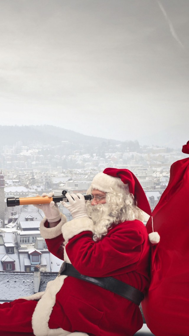 2014 christmas santa sitting on the roof with telescope-f69279