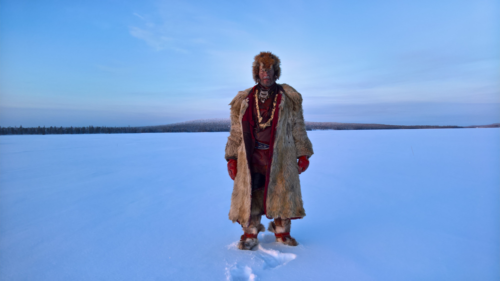 Jari Rorn a Lapland Shaman on the lake near his home in Keimioniementie, FInland. He has spent his life in this landscape. Hunting, fishing, understanding the extreme north. It is more than 35 degrees below zero when this picture was made. Even cold for Jari...