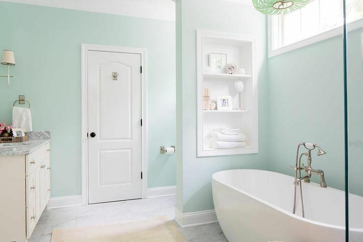 egg-shaped-tub-green-spa-like-bathroom-clerestory-window-59a5a8df396e5a001133e9d8